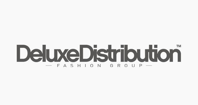 ALEKS UND SHANTU Kundenlogo Deluxe Distribution grau